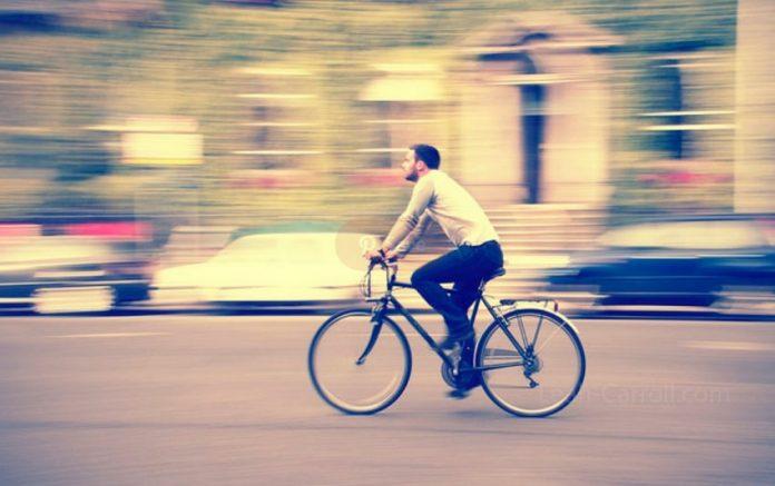 Man riding bike